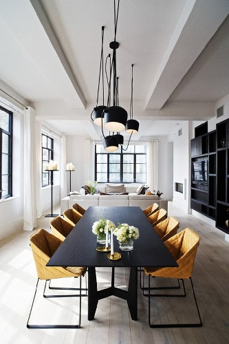 get the look 17 mid centurydining area Find the perfect chandelier, a modern foot lamp, some patterned details and beautiful chairs