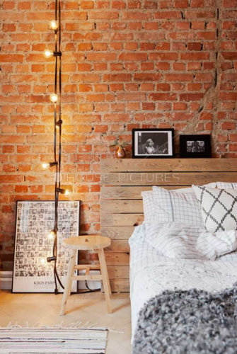 5 Ways to get an industrial style to your home wooden headboard,     mixed with diamond + grid pattern pillows via stylecaster