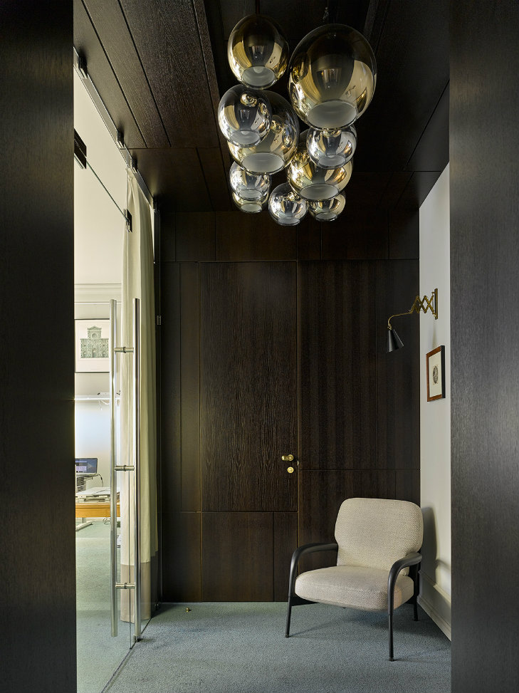 Apartment in Russia featuring midcentury modern furniture & lighting