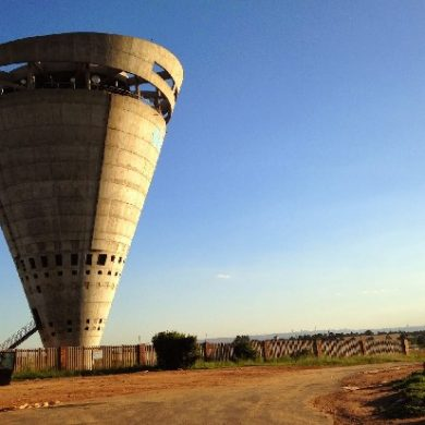 Brutalist Architecture cheek to cheek with Modern Designs Midrand water tower, South Africa. dizzy